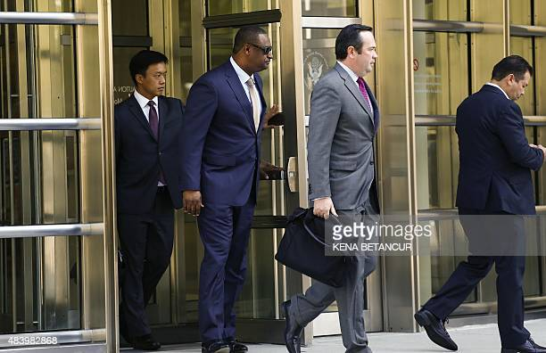 Jeffrey Webb former FIFA vice president walks with his attorney Edward O'Callaghan after leaving from from his hearing at the Brooklyn Federal...