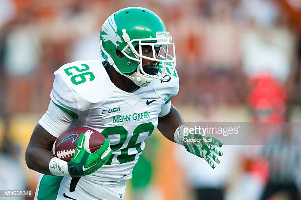 Jeffrey Wilson of the North Texas Mean Green breaks free against the Texas Longhorns on August 30 2014 at Darrell K RoyalTexas Memorial Stadium in...