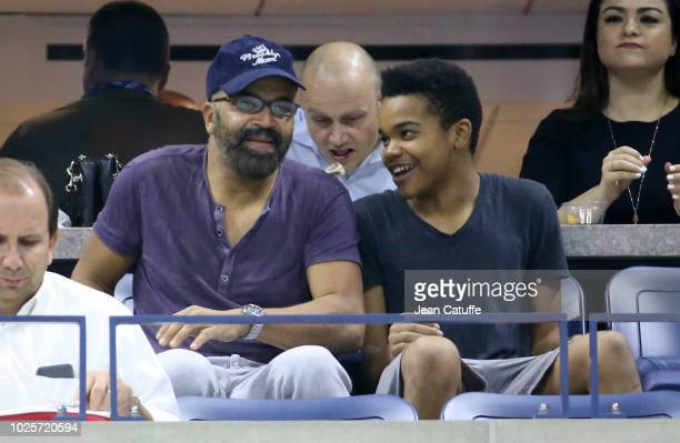 Jeffrey Wright and his son Elijah Wright attend the Serena and Venus Williams' third round match on day 5 of the 2018 tennis US Open on Arthur Ashe...