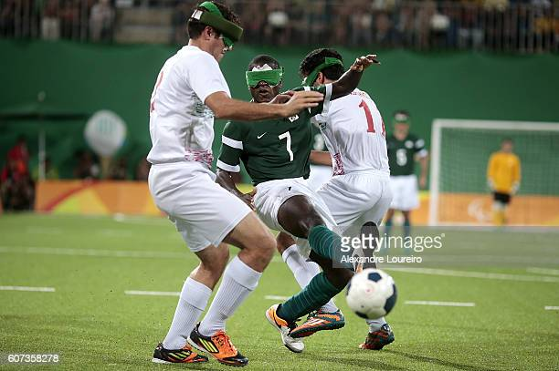 Jefinho of Brazil fights for the ball with Amir Pourrazavi and Ahmadreza Shahhosseini of Iran during the Football 5aside Brazil and Iran Gold Medal...