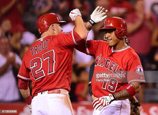 Jefry Marte of the Los Angeles Angels celebrates his grand slam homerun with Mike Trout to take a 51 lead over the Oakland Athletics during the...