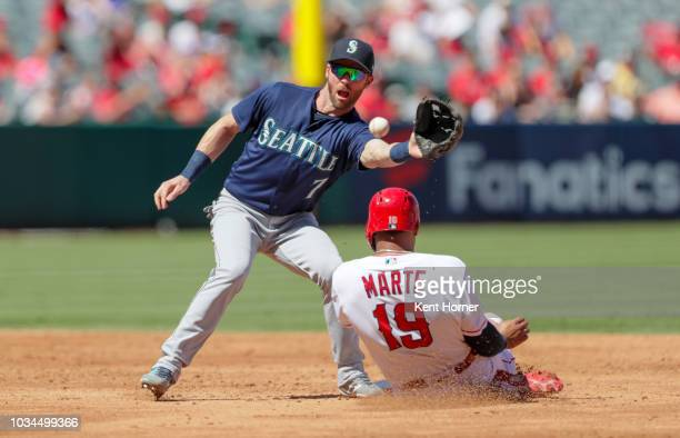Jefry Marte of the Los Angeles Angels is tagged out trying to steal 2nd base in the 2nd inning against Andrew Romine of the Seattle Mariners at Angel...