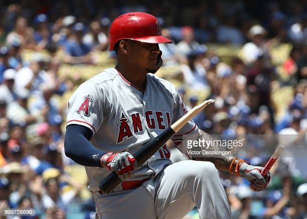 Jefry Marte of the Los Angeles Angels of Anaheim breaks his bat after striking out with the bases loaded in the first inning during the MLB game...