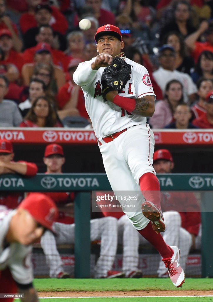 Jefry Marte #19 of the Los Angeles Angels of Anaheim throws out Robinson Chirinos #61 of the Texas Rangers at first base in the seventh inning of the game at Angel Stadium of Anaheim on August 21, 2017 in Anaheim, California.