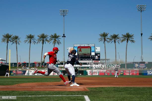 Jefry Marte of the Los Angeles Angels runs safely to first as Nellie Rodriguez of the Cleveland Indians awaits the throw in the second inning during...