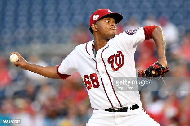 Michael Taylor of the Washington Nationals drives in a run with a single in the ninth inning against the Philadelphia Phillies at Nationals Park on...