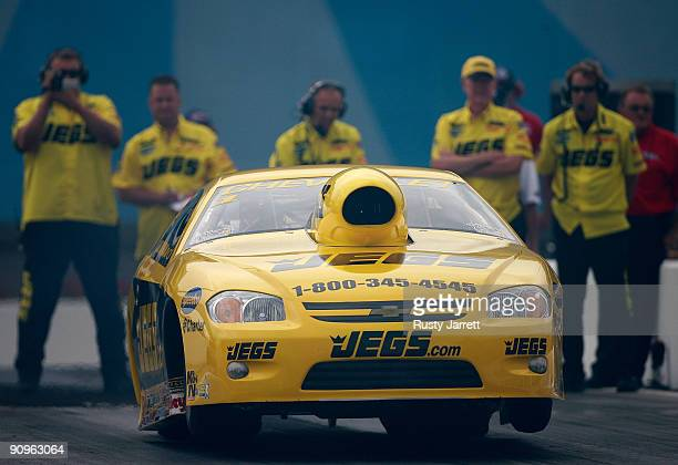 Jeg Coughlin Jr driver of the Jeg'scom Chevy Cobalt drives during first round qualifying for the NHRA Carolinas Nationals on September 18 2009 at...