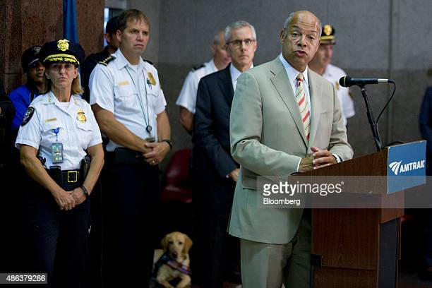 Jeh Johnson US secretary of Homeland Security right speaks during a news conference with Peter Neffenger administrator of the Transportation Security...