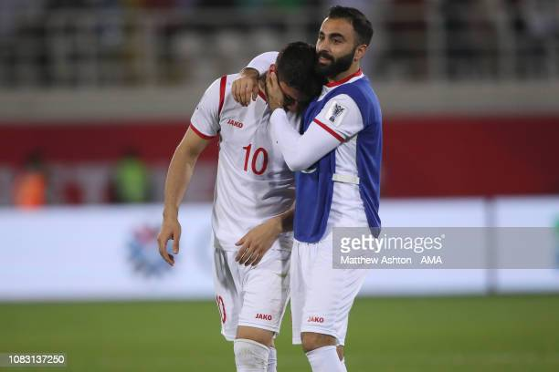 Jehad Al Baour of Syria consoles a dejected Mohammed Osman of Syria at full time during the AFC Asian Cup Group B match between Australia and Syria...