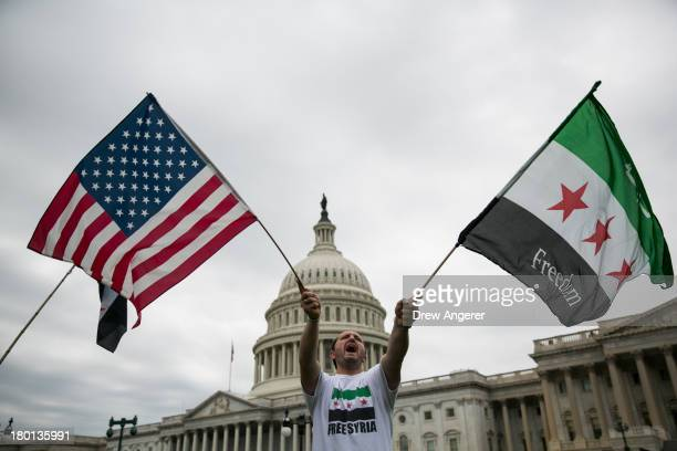 Jehad Sibai waves flags during a rally in support of possible U.S. Military action in Syria, on Capitol Hill, on September 9, 2013 in Washington, DC....