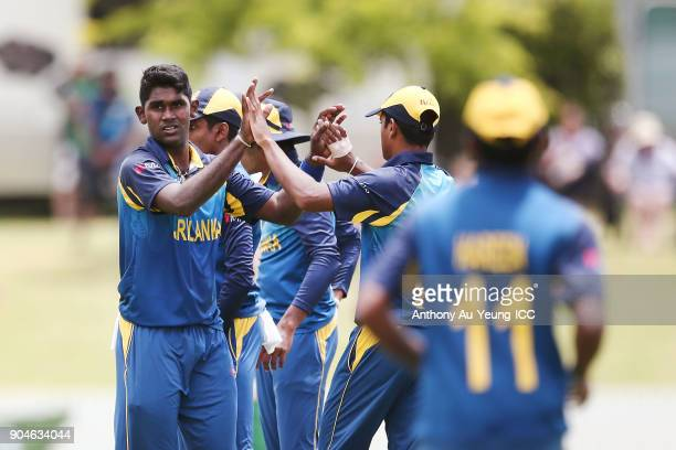 Jehan Daniel of Sri Lanka celebrates with teammates for the wicket of Jamie Grassi of Ireland during the ICC U19 Cricket World Cup match between Sri...