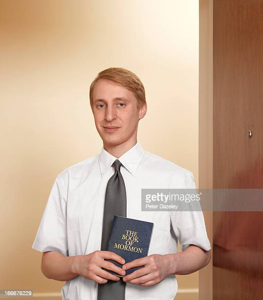 Jehovah's witness with book of mormon