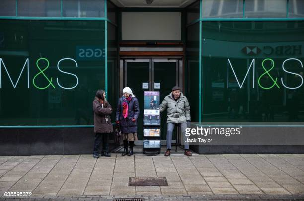 Jehovah's Witnesses distribute literature outside a closed down Marks and Spencer on February 7 2017 in Great Yarmouth United Kingdom The town of...