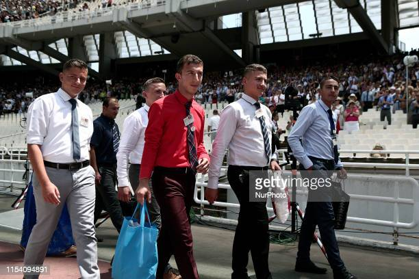 Jehovah's Witnesses prepare to get baptized the second day of the Jehovahs Witnesses Convention at the Olympic stadium in Athens Greece on July 6 2019