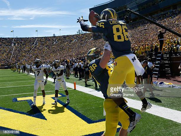 Jehu Chesson of the Michigan Wolverines celebrates a third quarter touchdown with Jake Butt while playing the Akron Zipsat Michigan Stadium on...