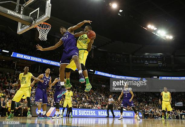 Jehyve Floyd of the Holy Cross Crusaders blocks a shot by Elgin Cook of the Oregon Ducks in the second half during the first round of the 2016 NCAA...