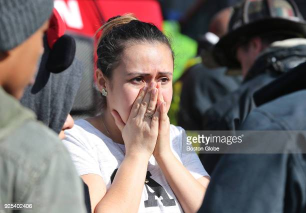Jeidy Martinez reacts as she talks to an official outside 238 Havre St in East Boston where firefighters were battling a multialarm fire on Feb 27...