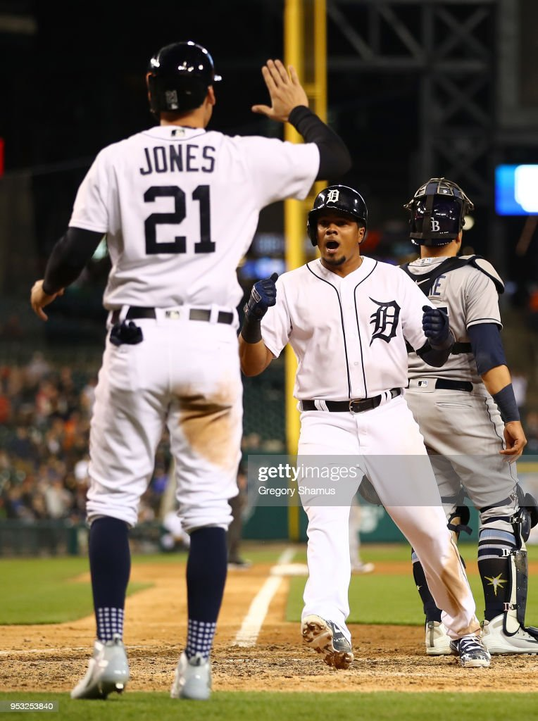 Jeimer Candelario #46 and JaCoby Jones #21 of the Detroit Tigers celebrate scoring in the ninth inning while playing the Tampa Bay Rays at Comerica Park on April 30, 2018 in Detroit, Michigan. Tampa Bay won the game 3-2.