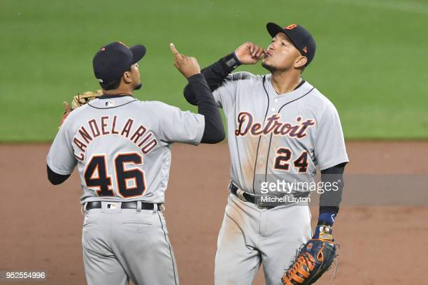 Jeimer Candelario and Miguel Cabrera of the Detroit Tigers celebrate a win during a baseball game against the Detroit Tigers at Oriole Park at Camden...
