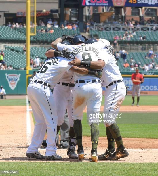 Jeimer Candelario James McCann Nicholas Castellanos and Dixon Machado of the Detroit Tigers celebrate a grand slam home run hit by McCann while...