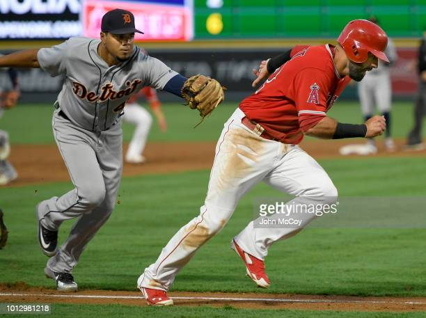 Jeimer Candelario of the Detroit Tigers catches Kaleb Cowart of the Los Angeles Angels of Anaheim in a rundown in the first inning at Angel Stadium...