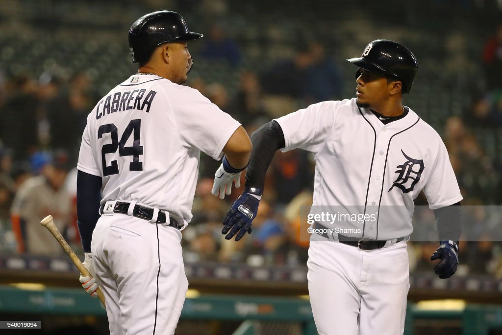 Jeimer Candelario #46 of the Detroit Tigers celebrates a eighth inning home run with Miguel Cabrera #24 while playing the New York Yankees at Comerica Park on April 13, 2018 in Detroit, Michigan. New York won the game 8-6.