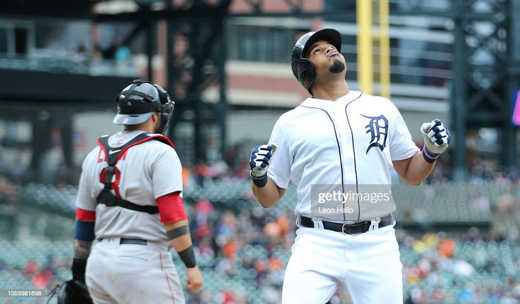 Jeimer Candelario #46 of the Detroit Tigers celebrates a solo home run in the seventh inning of the game against the Boston Red Sox at Comerica Park on July 22, 2018 in Detroit, Michigan.