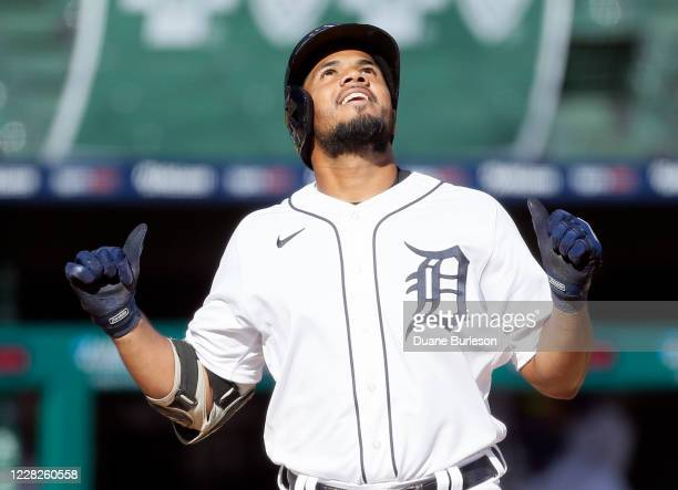 Jeimer Candelario of the Detroit Tigers celebrates after hitting a two-run home run against the Minnesota Twins during the third inning of game two...