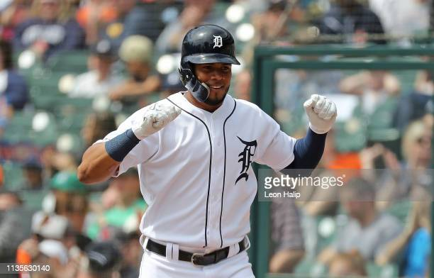 Jeimer Candelario of the Detroit Tigers celebrates after scoring on the triple by Christin Stewart during the second inning of the game against the...