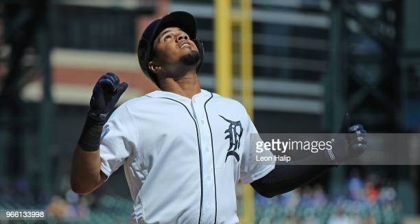 Jeimer Candelario of the Detroit Tigers celebrates at home plate after hitting a solo first inning home run during the game against the Toronto Blue...