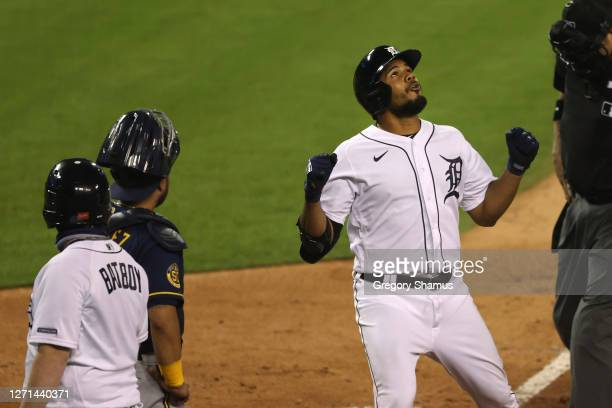 Jeimer Candelario of the Detroit Tigers celebrates his two run seventh inning home run in front of Omar Narvaez of the Milwaukee Brewers in the fifth...