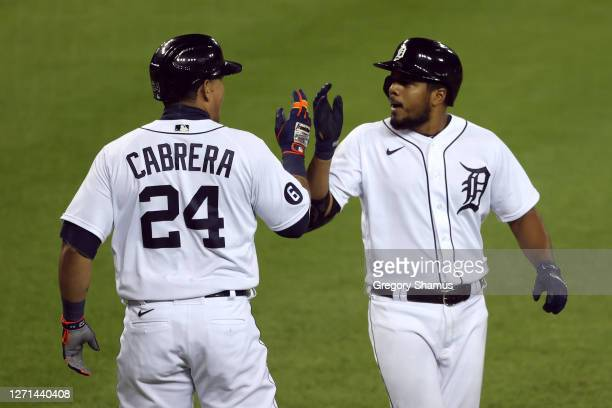 Jeimer Candelario of the Detroit Tigers celebrates his two run seventh inning home run with Miguel Cabrera while playing Milwaukee Brewers in the...