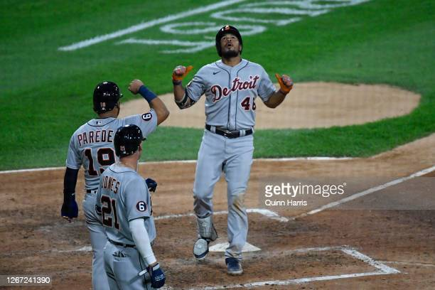 Jeimer Candelario of the Detroit Tigers celebrates with Isaac Paredes and JaCoby Jones of the Detroit Tigers after his three-run home run in the...