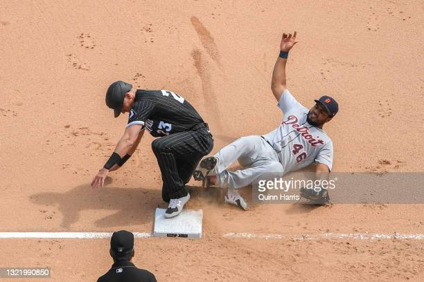 Jeimer Candelario of the Detroit Tigers gets the force out at third base in the sixth inning against Jake Lamb of the Chicago White Sox at Guaranteed...