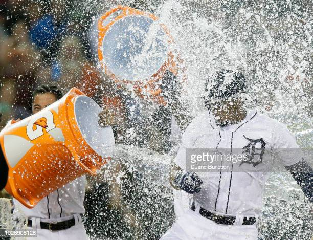 Jeimer Candelario of the Detroit Tigers has water dumped on him by teammates after hitting a walkoff tworun home run to defeat the St Louis Cardinals...