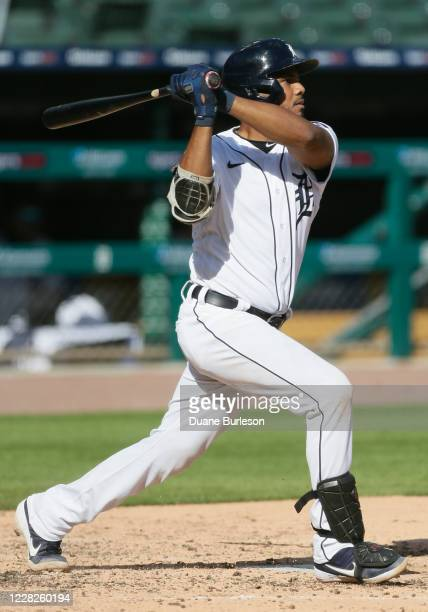 Jeimer Candelario of the Detroit Tigers hits a two-run home run against the Minnesota Twins during the third inning of game two of a doubleheader at...