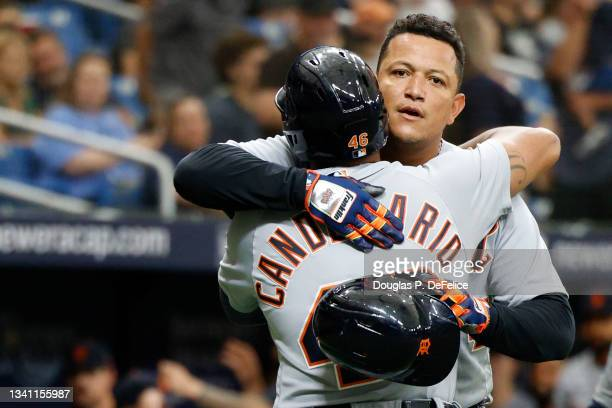 Jeimer Candelario of the Detroit Tigers reacts with teammate Miguel Cabrera after hitting a three-run home run during the first inning against the...