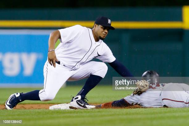 Jeimer Candelario of the Detroit Tigers tags out Jorge Polanco of the Minnesota Twins trying to steal second base during the third inning at Comerica...
