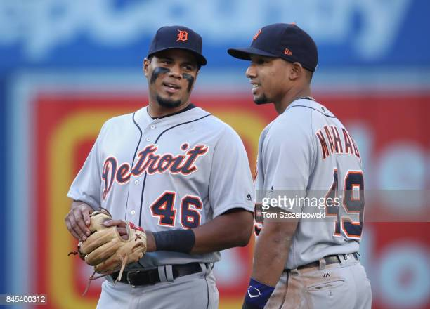Jeimer Candelario of the Detroit Tigers talks to Dixon Machado during a break in the action during MLB game action against the Toronto Blue Jays at...