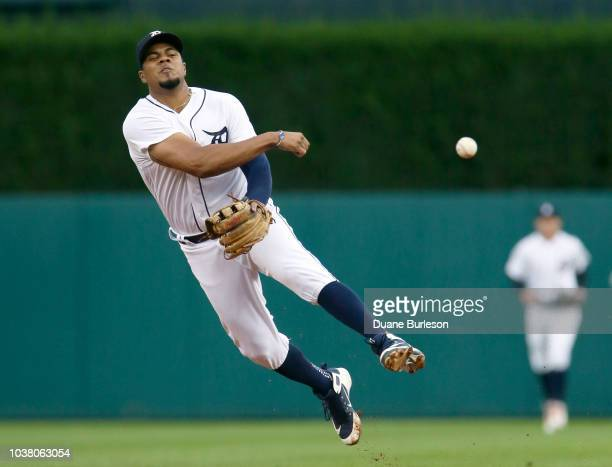 Jeimer Candelario of the Detroit Tigers throws out Brian Goodwin of the Kansas City Royals at first base during the second inning at Comerica Park on...