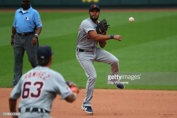 Jeimer Candelario of the Detroit Tigers throws to first base for an out against the St. Louis Cardinals in the fifth inning during game one of a...
