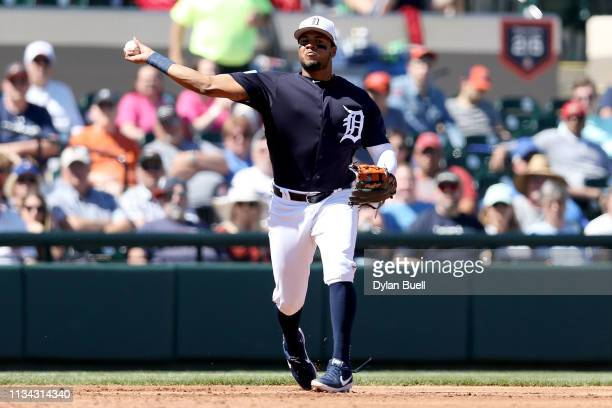 Jeimer Candelario of the Detroit Tigers throws to first base in the third inning against the Philadelphia Phillies during the Grapefruit League...