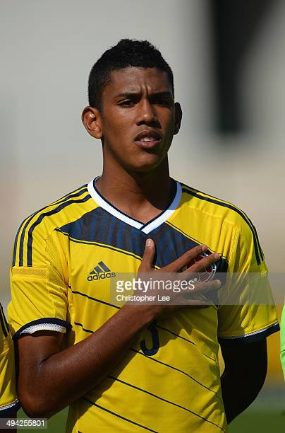 Jeison Angulo of Colombia sings his national anthem during the Toulon Tournament Group B match between Colombia and Qatar at the Stade De Lattre on...
