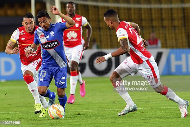 Jeison Gordillo of Colombia's Santa Fe vies for the ball with Angel Mena of Ecuador's Emelec during their 2015 Sudamericana Cup football match held...