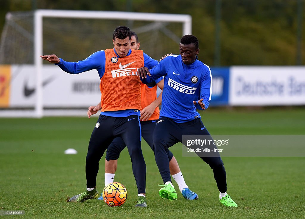 Jeison Murillo (L) and Assane Gnoukouri compete for the ball during a FC Internazionale training session at the club's training ground at Appiano Gentile on October 29, 2015 in Como, Italy.