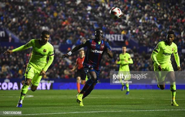 Jeison Murillo and Nelson Semedo of Barcelona and Emmanuel Boateng of Levante chase the ball during the Copa del Rey Round of 16 match between...
