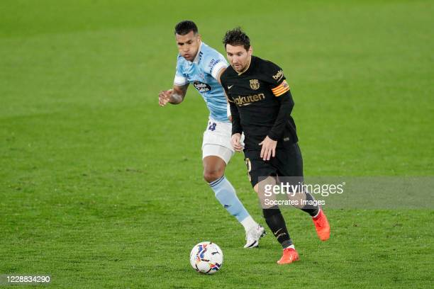 Jeison Murillo of Celta de Vigo Lionel Messi of FC Barcelona during the La Liga Santander match between Celta de Vigo v FC Barcelona at the Estadio...