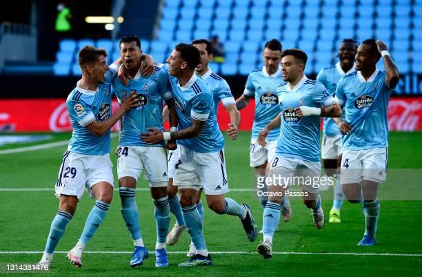 Jeison Murillo of Celta Vigo celebrates after scoring their team's second goal with Jose Fontan and Santi Mina during the La Liga Santander match...