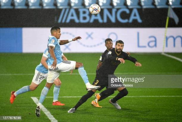Jeison Murillo of Celta wins a header over Gerard Pique of Barcelona during the La Liga Santander match between RC Celta and FC Barcelona at...