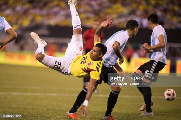 Jeison Murillo of Colombia challenged by Leandro Paredes of Argentina during the Argentina Vs Colombia International Friendly football match at...